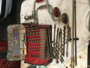 Two hand drills and bits