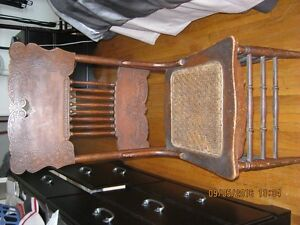 100 yr old Antique Chair with Wicker seat.