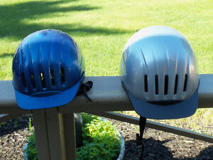 TWO RIDING HELMETS BY INTERNATIONAL