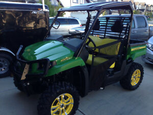 Mint condition John Deere Gator with winch and snowblade. 40hrs