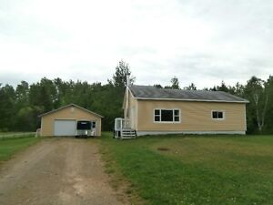 Cozy two bedrooms house sitting on 2.5 acres of land.