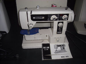 Universal 803L Sewing Machine, with Carrying Case