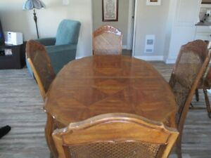 Dining Rm Table with 4 chairs and center piece well used