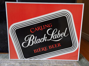 Foster's and Carling Black Label cardboard framed signs