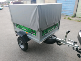 Daxara 127 trailer with extended mesh sides and cover