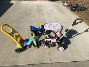 Push / Peddle kids trikes for taking young ones for walks.