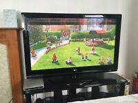 "Lg 50"" plasma lcd TV and black glass tv stand"