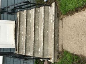 Concrete stairs with attached railing