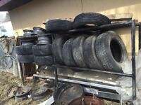 ****$100!!! HUGE TIRE RACK!! TIRES AND RIMS INCLUDED!!****