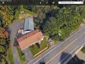 Terrain avec maison et garage 24 x 54