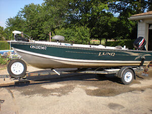 16 FT BOAT, MOTOR AND TRAILER