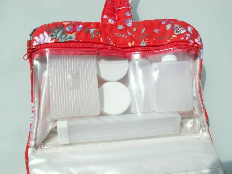 Red Floral Cosmetic Bag Double-Zipped with travel-size bottl