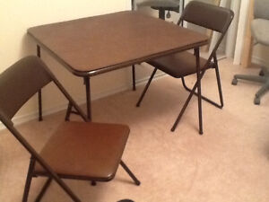 Sturdy card table and two folding chairs