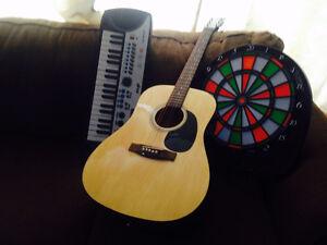 GUITAR,KEYBOARD PIANO AND ELECTRIC DART BOARD GAME