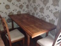 Barker and Stonehouse Flagstone dining table with 6 chairs. CD cabinet and coffee table included.