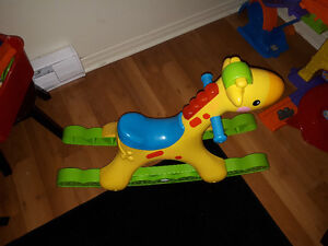Musical giraffe ride on toy