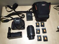 Nikon D5100 + 18-55mm lens + 55-200mm lens + grip + 6 batteries + bag + charger