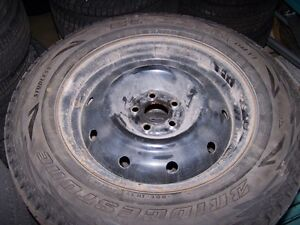 SET OF 4 USED BLIZZAK WS70 WINTER TIRES ON STEEL RIMS 215/70/R16