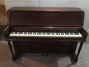 Free Piano --- require prpfession movers to pickup