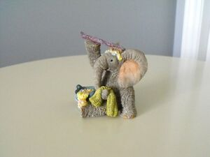 COLLECTIBLE TUSKERS FIGURINE