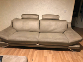 Beige 2 and 3 seater moder sofa with pouffe!
