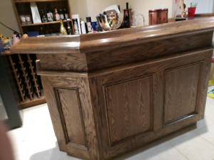 Oak bar with wine racks and cabinets