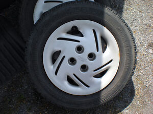 winter tires on rims with hubcaps