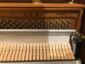 UPRIGHT KAWAI CX-5 IN GREAT CONDITION.