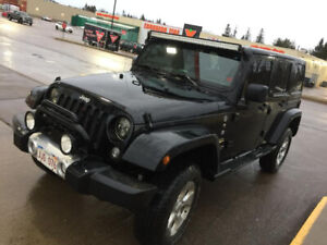2014 Jeep Wrangler, bought 2015 `Loaded` with soft top.