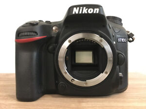 Nikon D7100 with 18-105mm lens +  memory card  + Lowepro bag