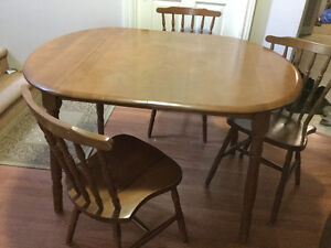 Solid wood dining table and 4 matching chairs delivery included
