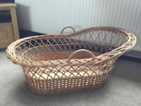 A LARGE WICKER CRIB