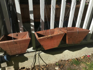 Three cedar hanging plant boxes