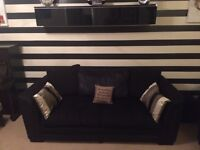 2 x 3 seater sofas in black, with cushions