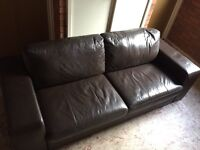 Brown faux leather 2 seater sofa.