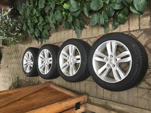 Michelin x-ice 215/55 R17 with OEM Nissan rims