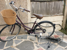 Ladies city bicycle with baskets