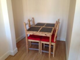 Dining table and chairs with cushions
