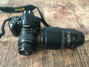 Nikon D3000 with 18-55mm lens and 55-300mm lens