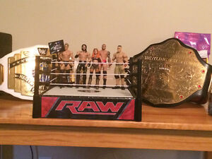 Two WWE Commemorative Belts and WWE Figure Collection and Ring