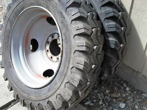 2 Firestone Heavy duty super traction tires and rims