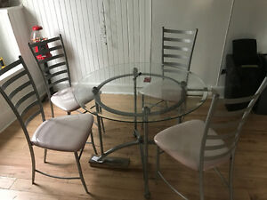 Glass dinning table and chairs