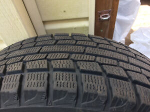 Snow Tires on Rims from a Pontiac Van. Asking $225 OBO