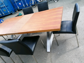 Dining table an six leather chairs