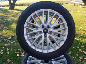 Set of 4 winter tires with rims.  $700 OBO