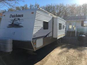 2008 Dutchmen 28ft travel trailer and 2012 Silverado package