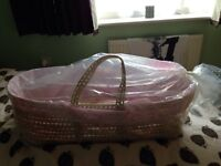 Pink Moses basket with stand