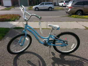 Girls bicycle Mystic by Trek light blue with floral pattern