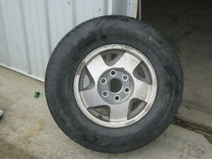 BRIDGESTONE LT245/75R16 TIRE ON GMC ALUMINUM RIM