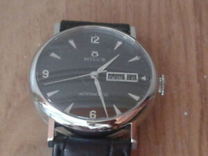 MILUS DAY DATE AUTOMATIC MINT CONDITION